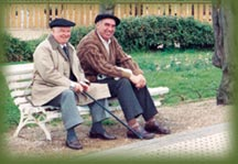 Two Basque men relax on a park bench
